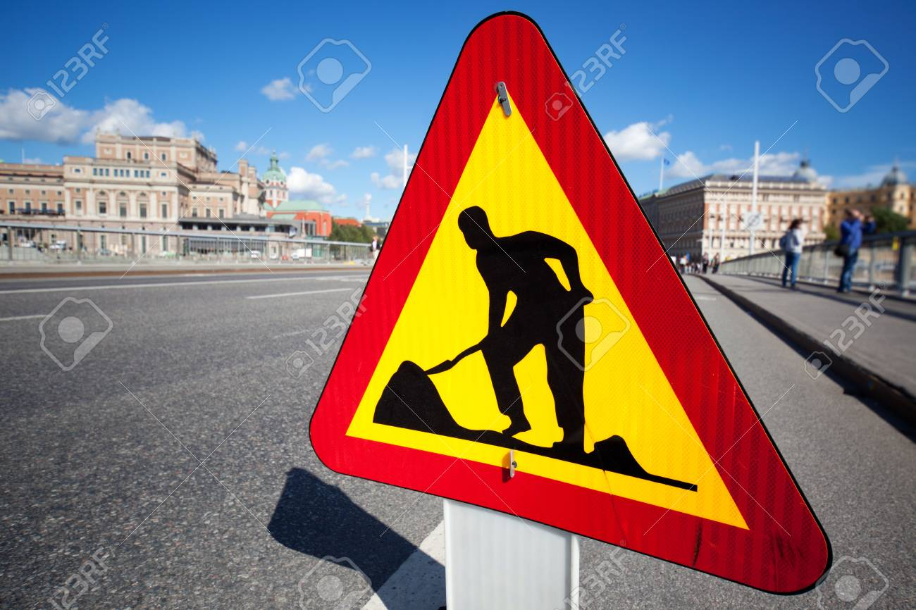 Caution digging sign on city background. Stock Photo - 10984995