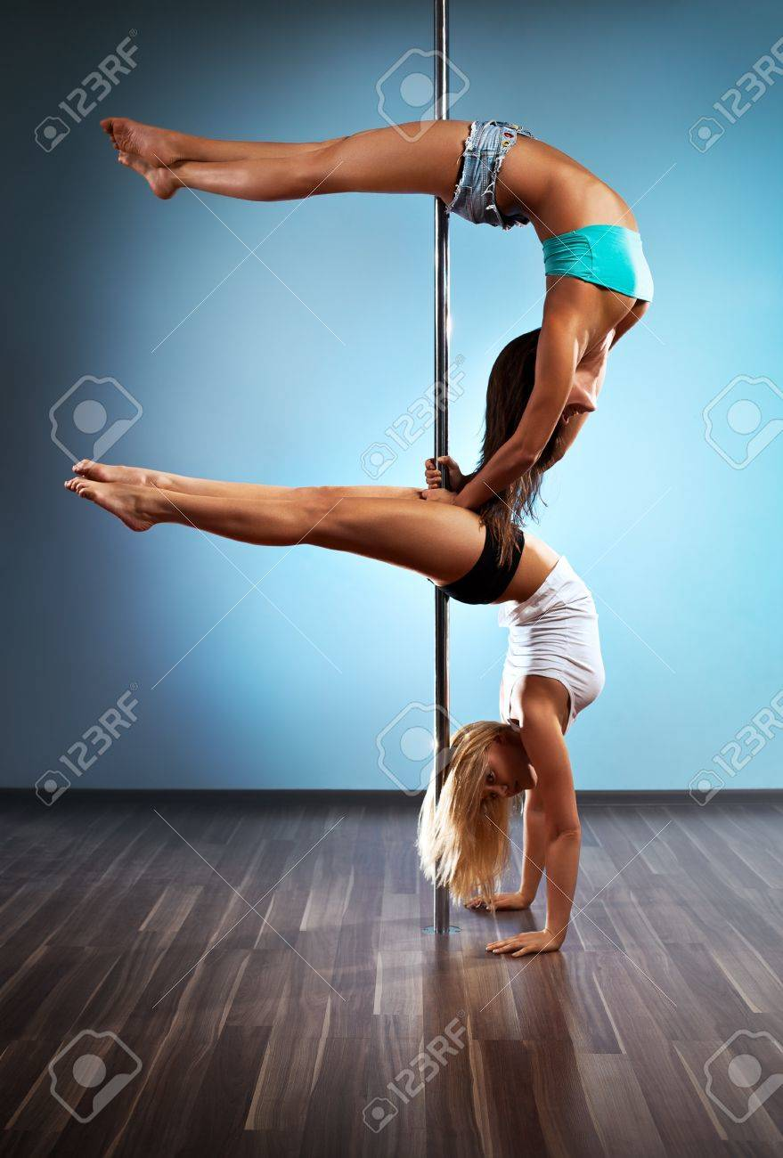 Two young sexy pole dance women. Stock Photo - 11744873