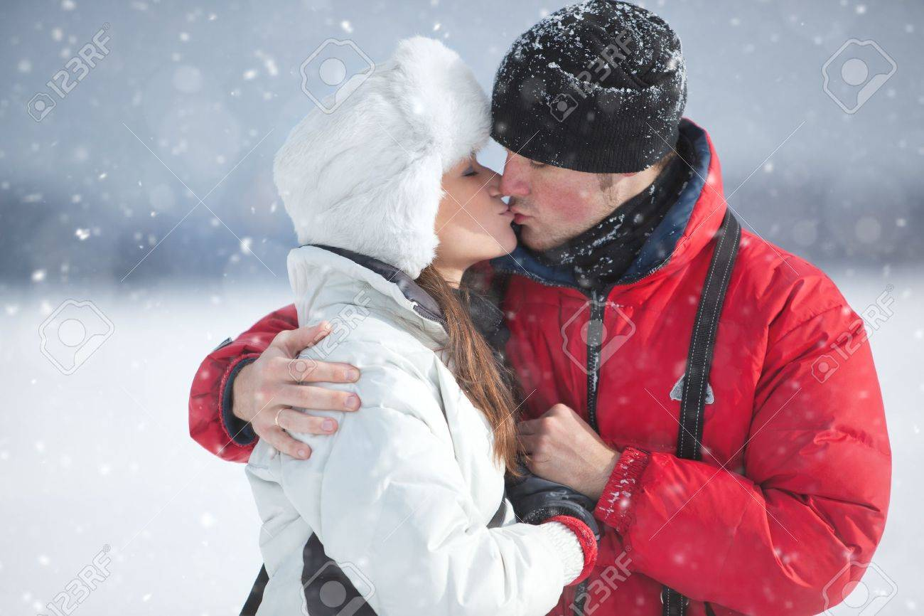 Young couple kissing winter outdoors portrait. Stock Photo - 12043695