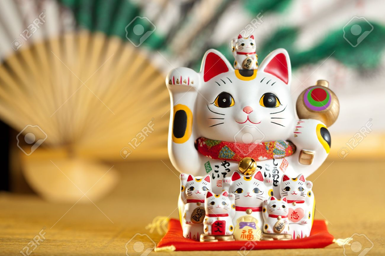 How To Bring Good Luck maneki neko cat. common japanese sculpture bring good luck to