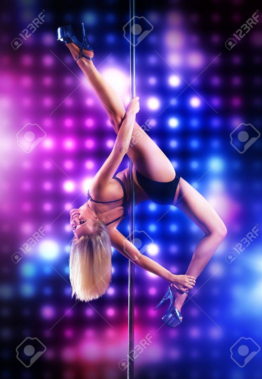 Young pole dance woman on lights background Stock Photo - 15368664