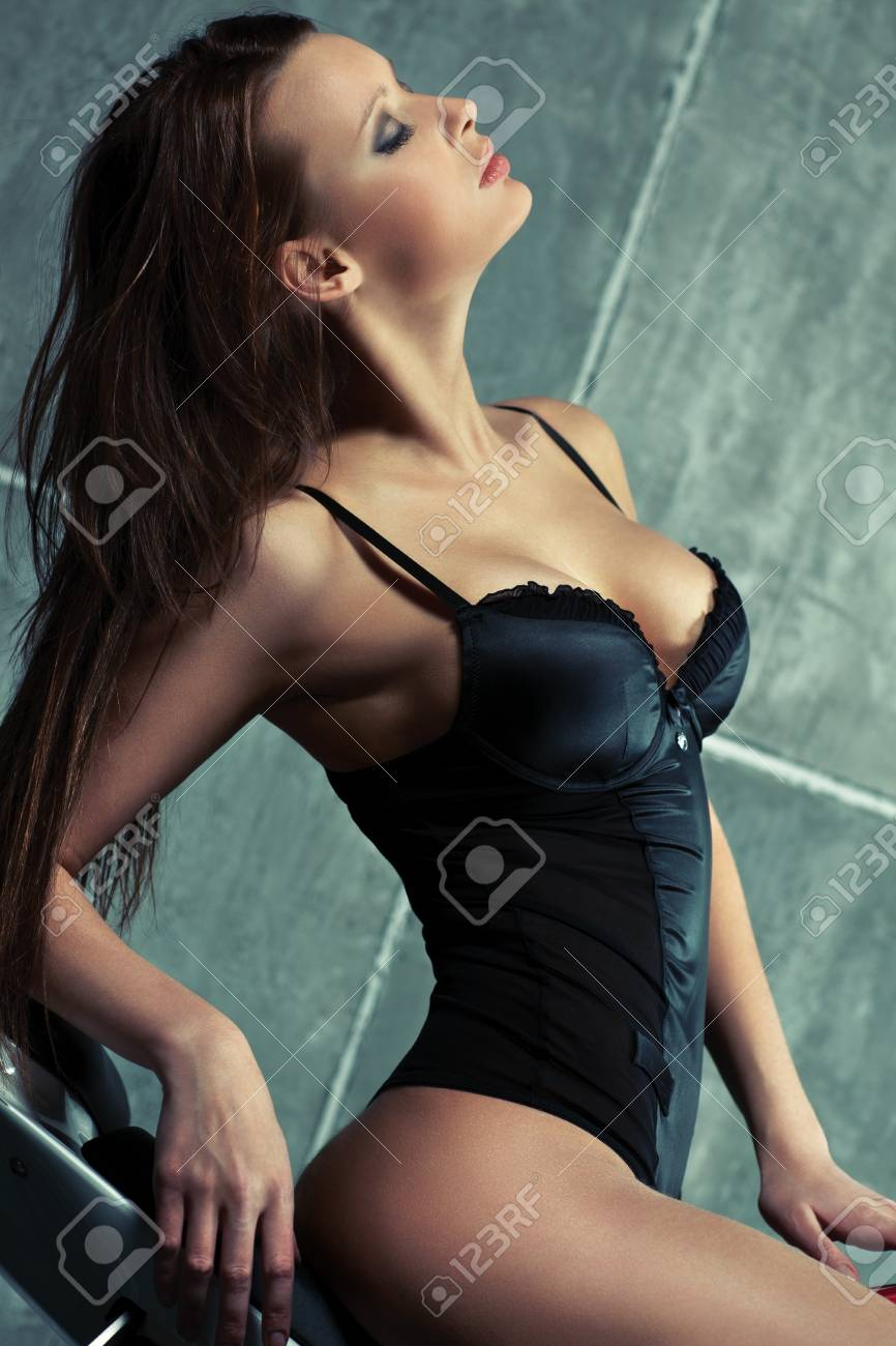 Young sexy woman portrait. On wall background. Stock Photo - 17383305