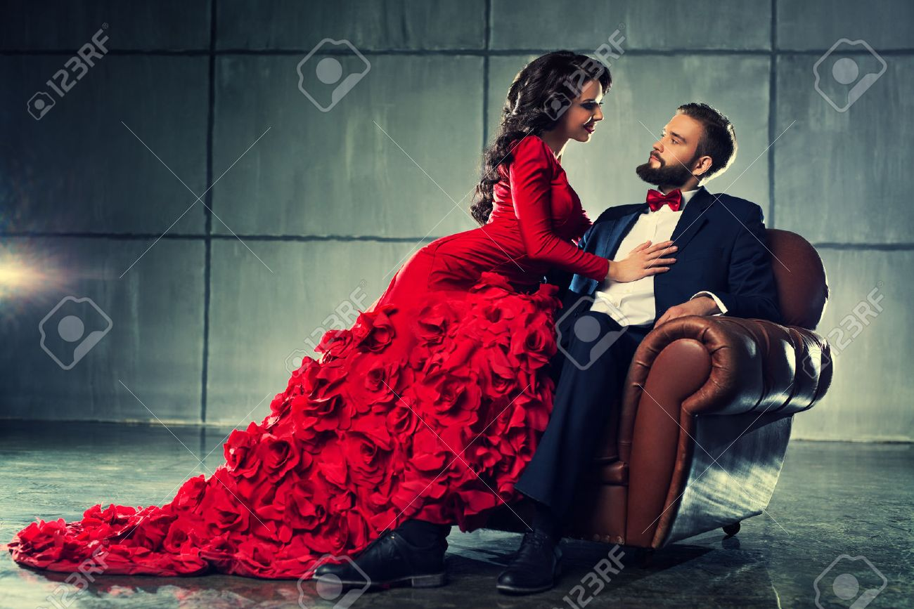 Stock photo dramatic red old fashioned elegant theater stage stock - Red Suit Young Elegant Loving Couple In Evening Dress Portrait Woman In Red And