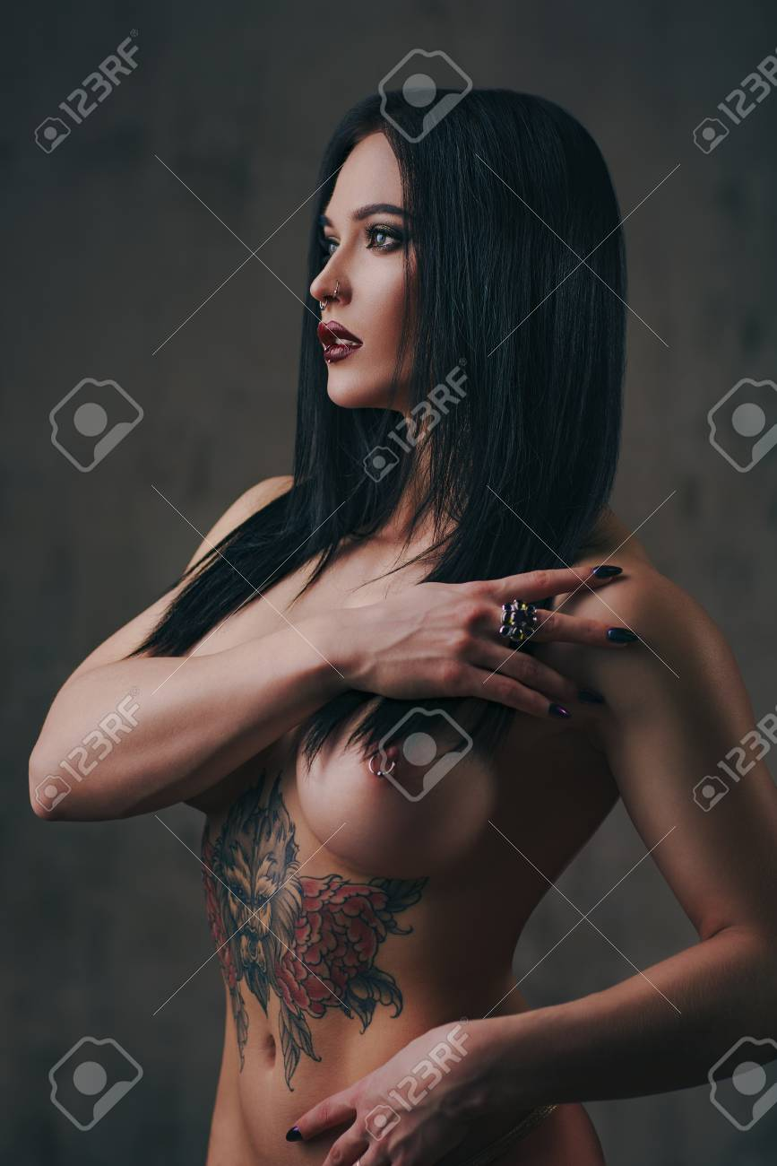 Turtleneck girlporn Tattooed And Pierced Naked Woman