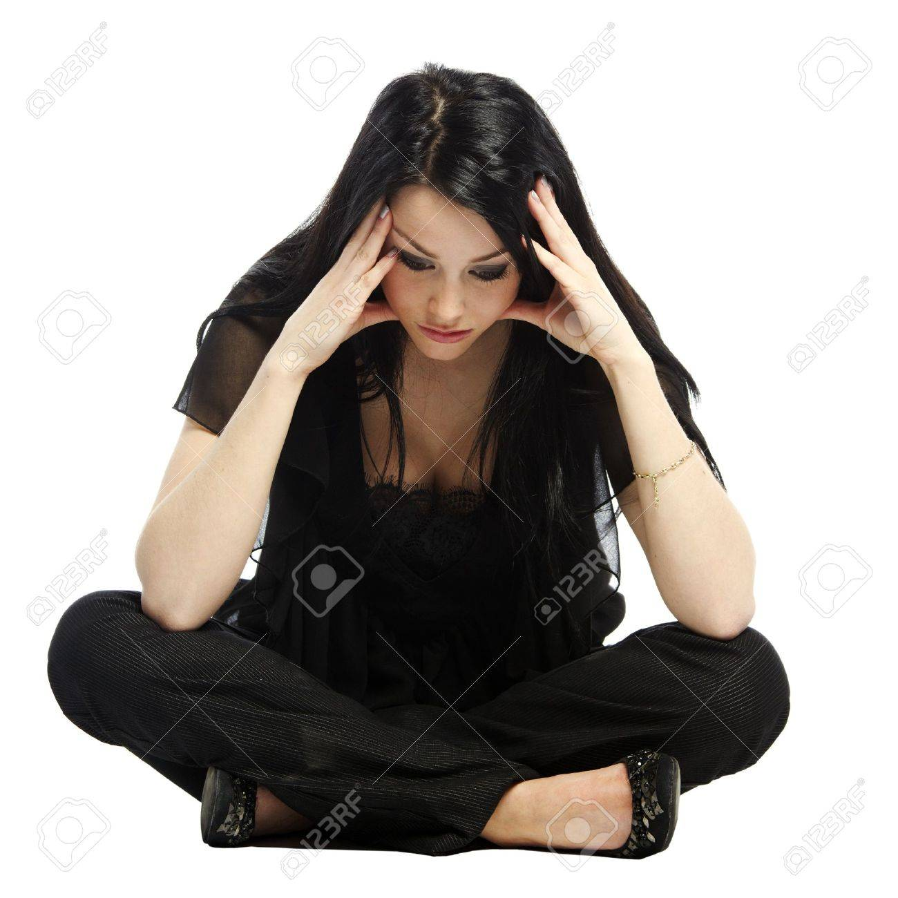 Young business casual woman worried with hands on head sitting Stock Photo - 11537486