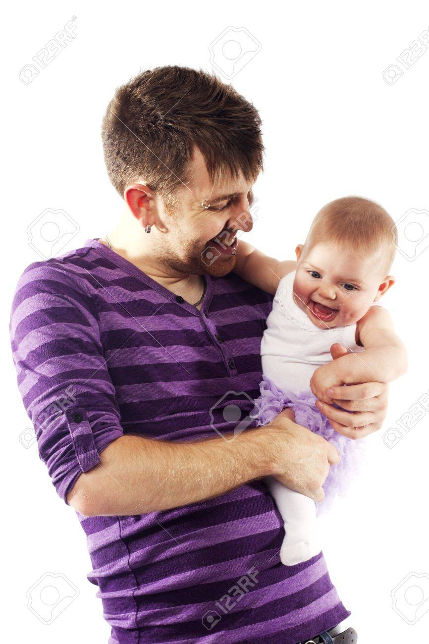 Cute little baby girl with beautiful eyes being held by her father Stock Photo - 15217990