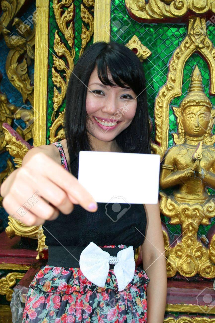 Asian woman holding card in Bangkok, Thailand. Stock Photo - 7986796