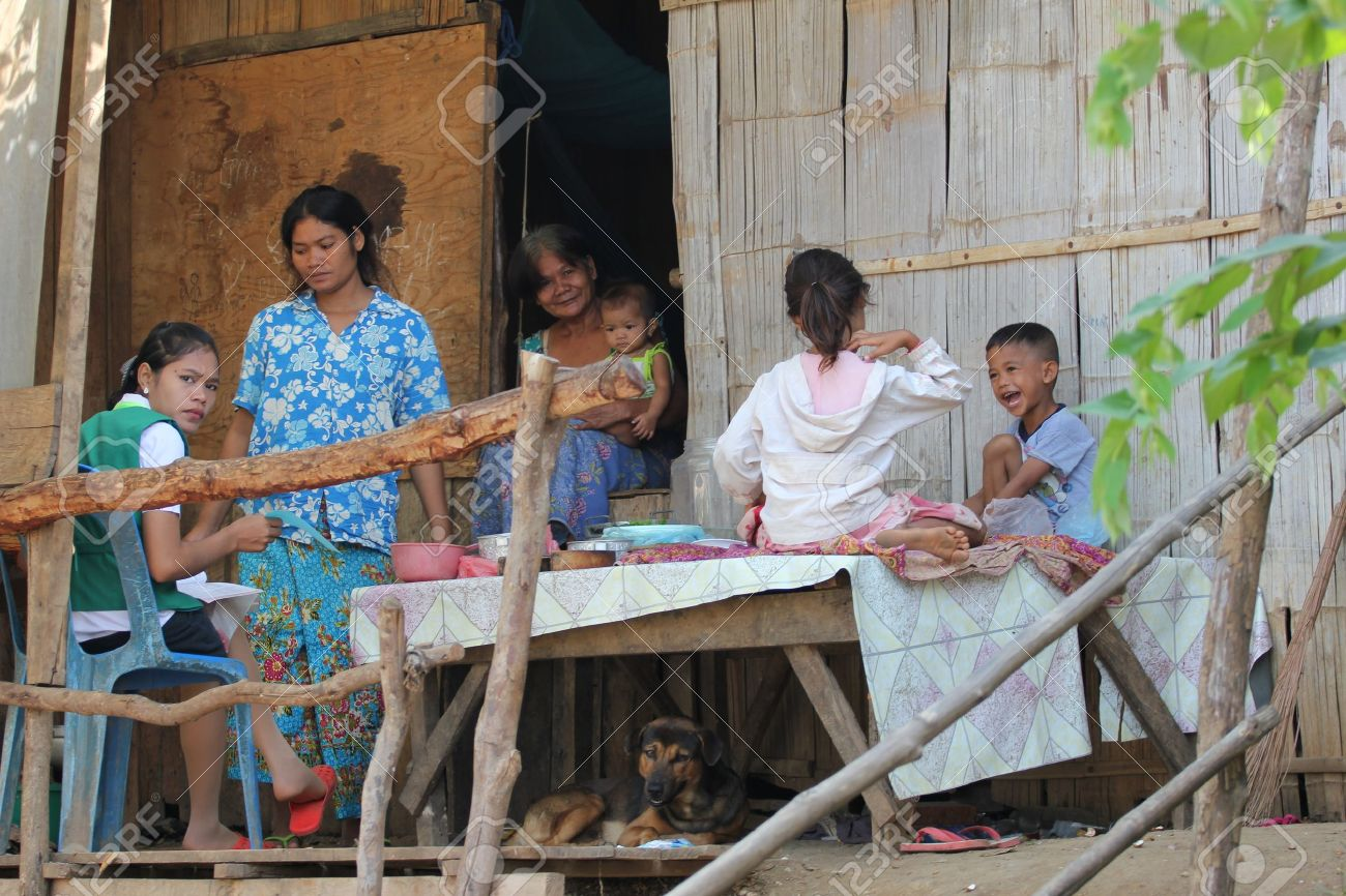 Cambodia -  July, 2011, Cambodian family in a house on a Thailand border town. Stock Photo - 10580709