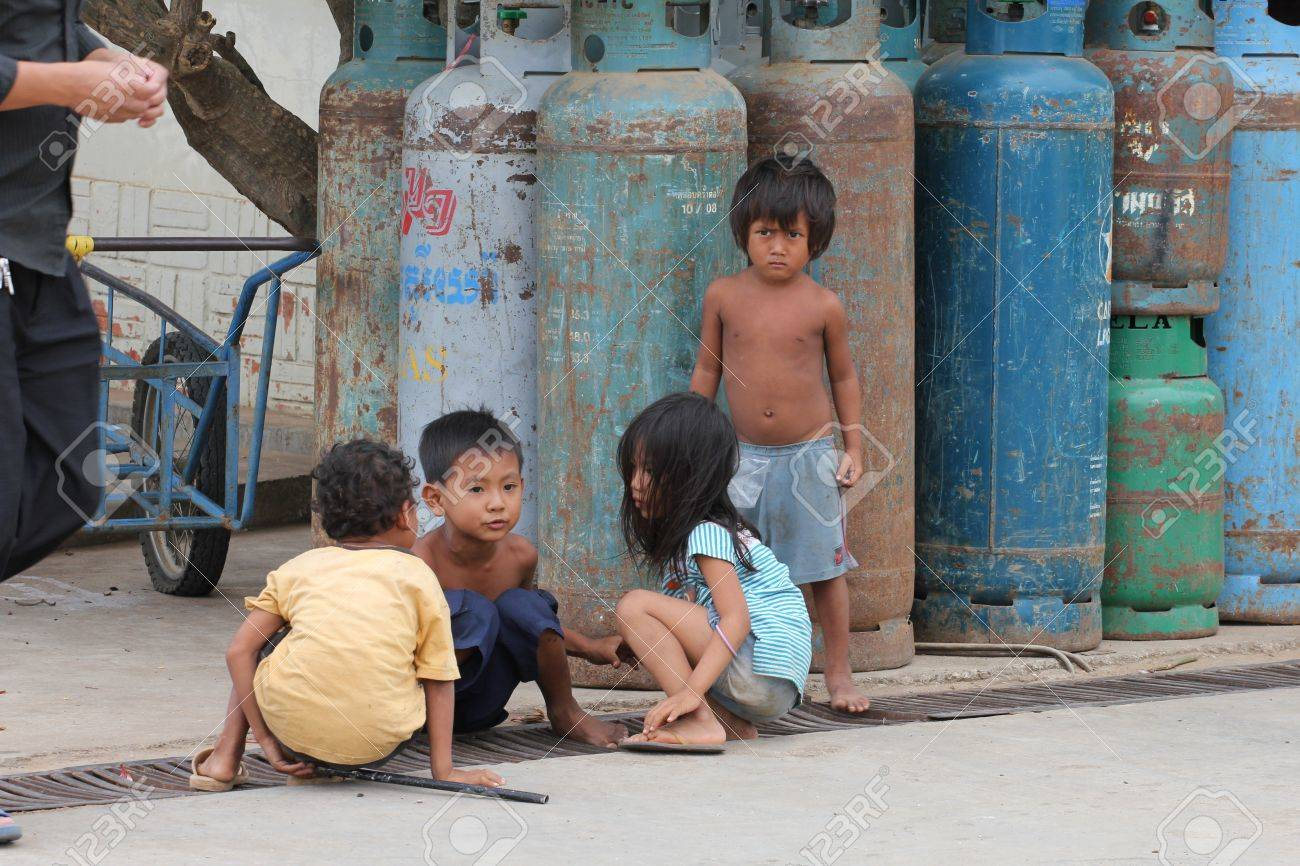 Cambodia -  July, 2011, Cambodian children on the streets of a Thailand border town. Stock Photo - 10580783