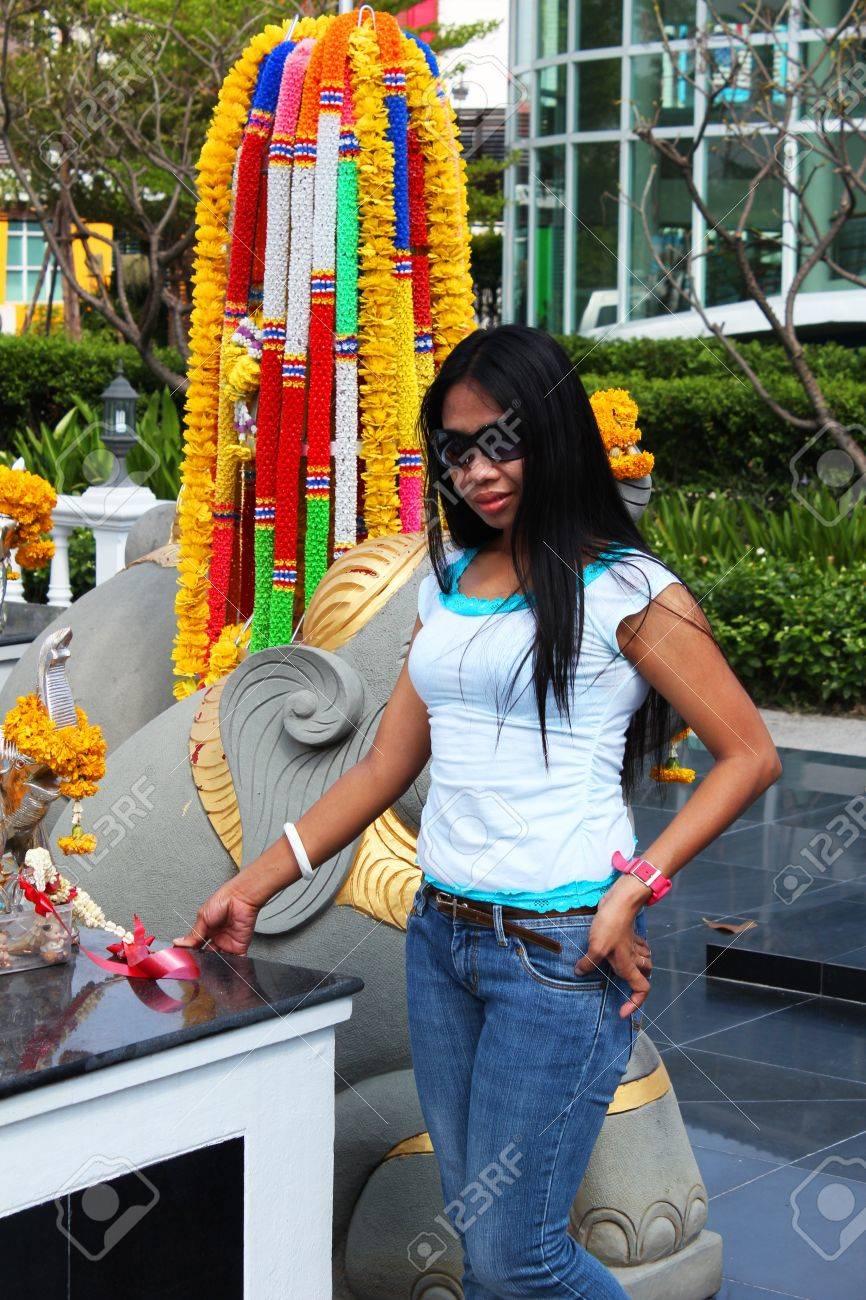 Filipino girl at a shrine in Bangkok, Thailand Stock Photo - 13754890