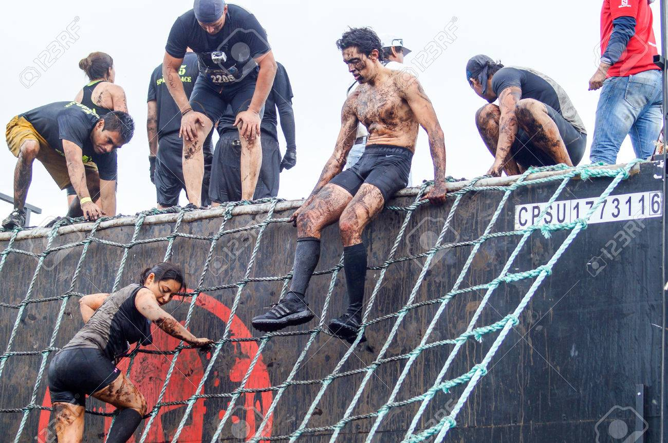 spartan race  Spartan Race Sprint. Athletes Crossing A Muddy Water Pond.The ...