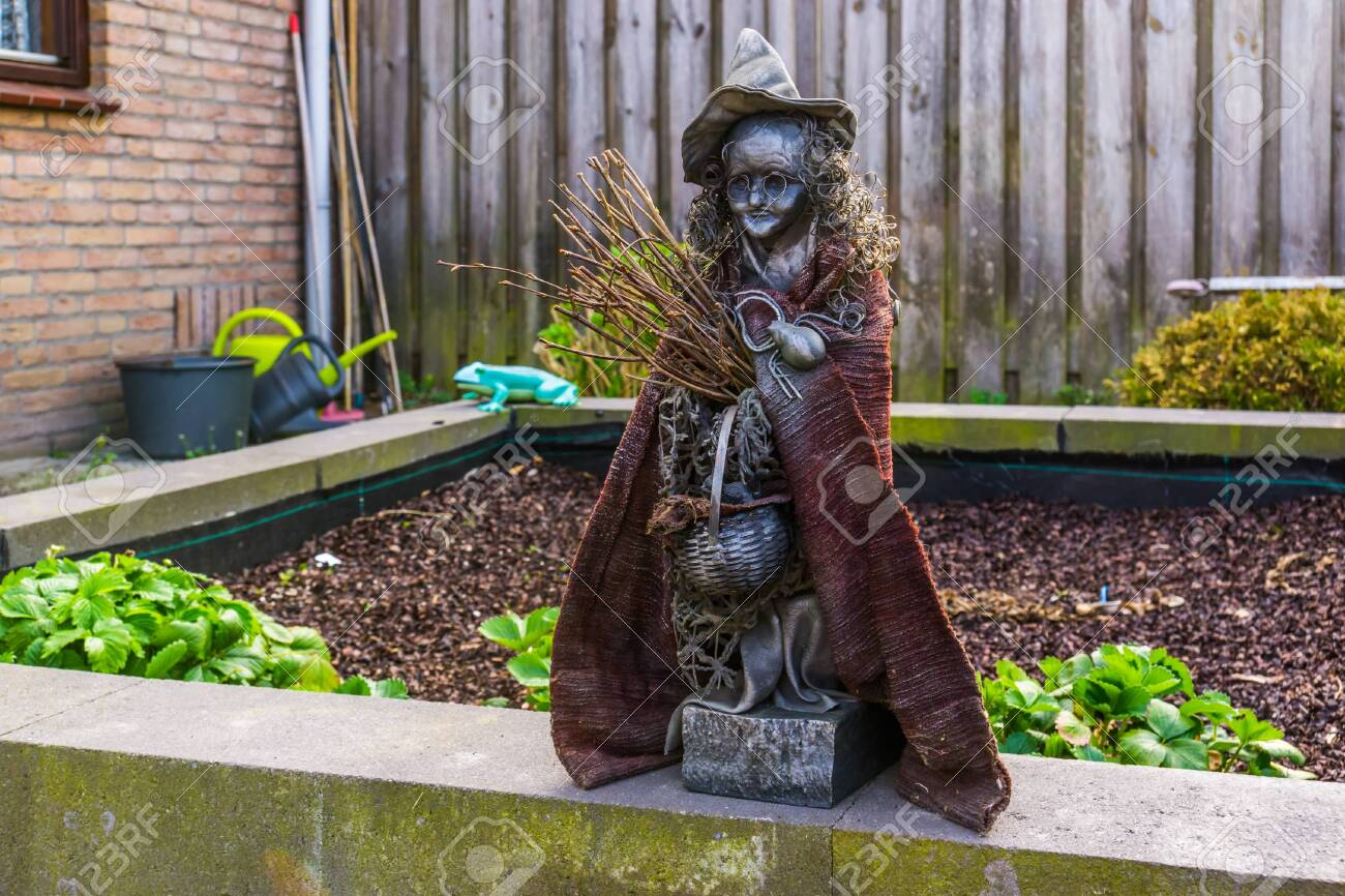 Spooky Witch Statuette In A Garden Outdoor Halloween Decorations