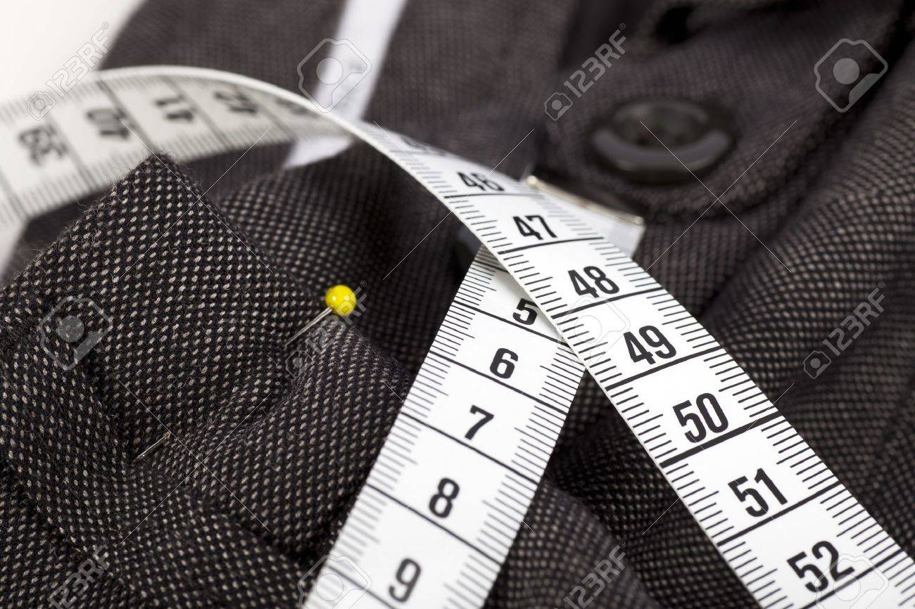 Measuring tape and trousers about to be altered. Stock Photo - 8158355