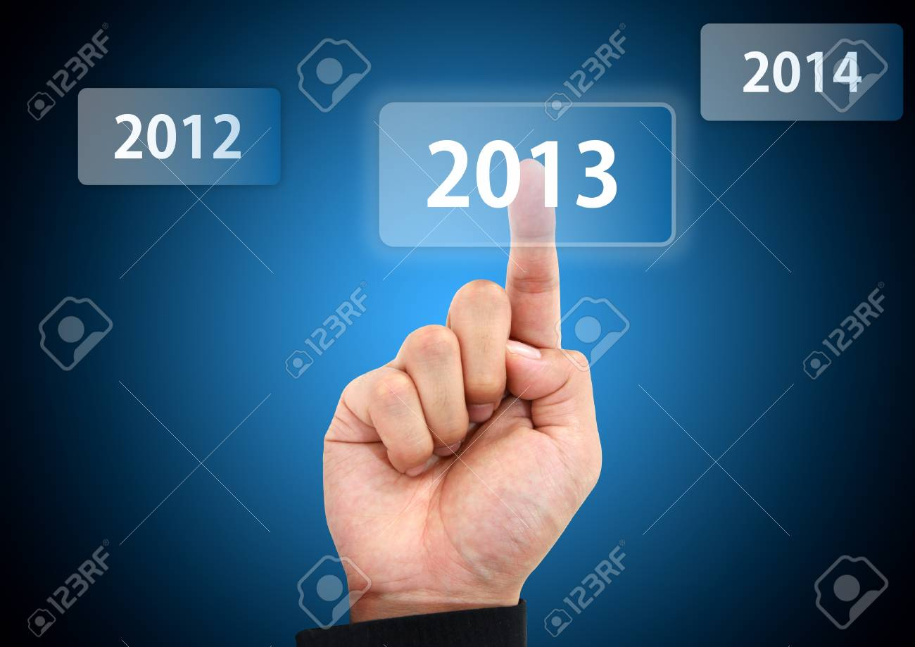 business hand pressing 2013 button Stock Photo - 16914116