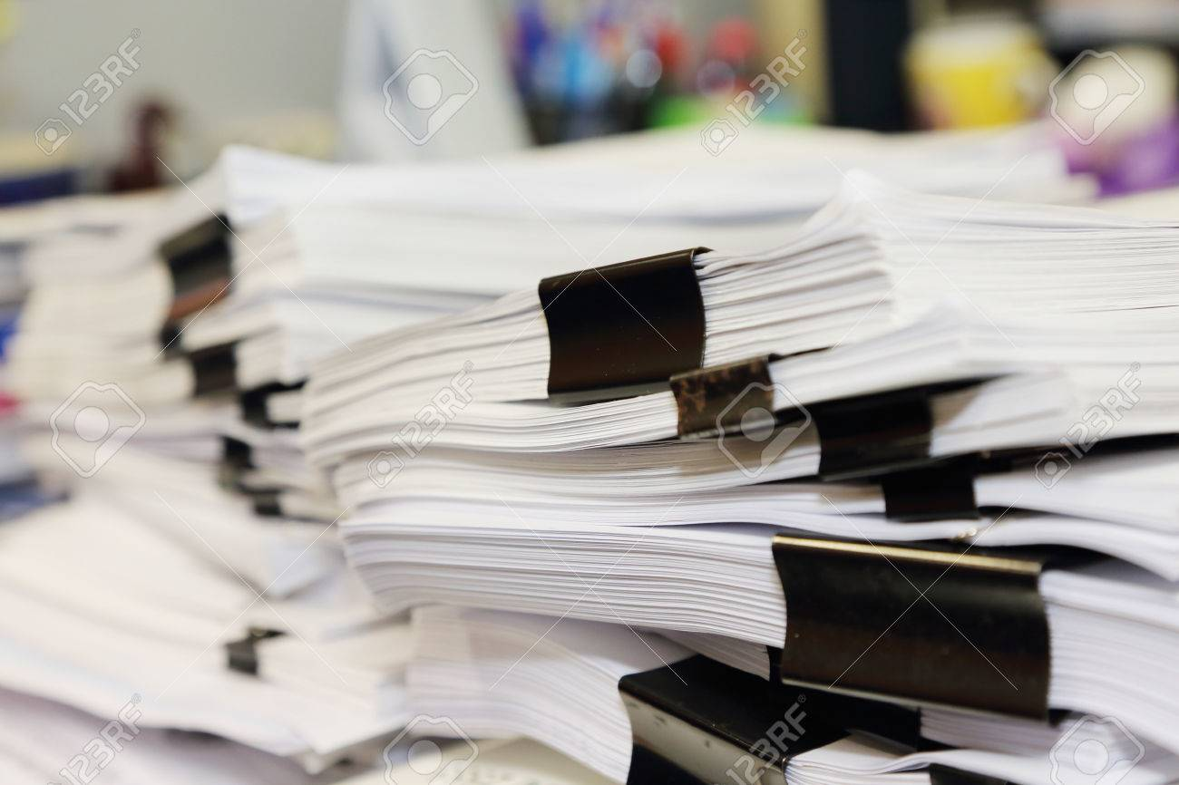 Pile Of Documents On The Office Desk Stock Photo, Picture And ...