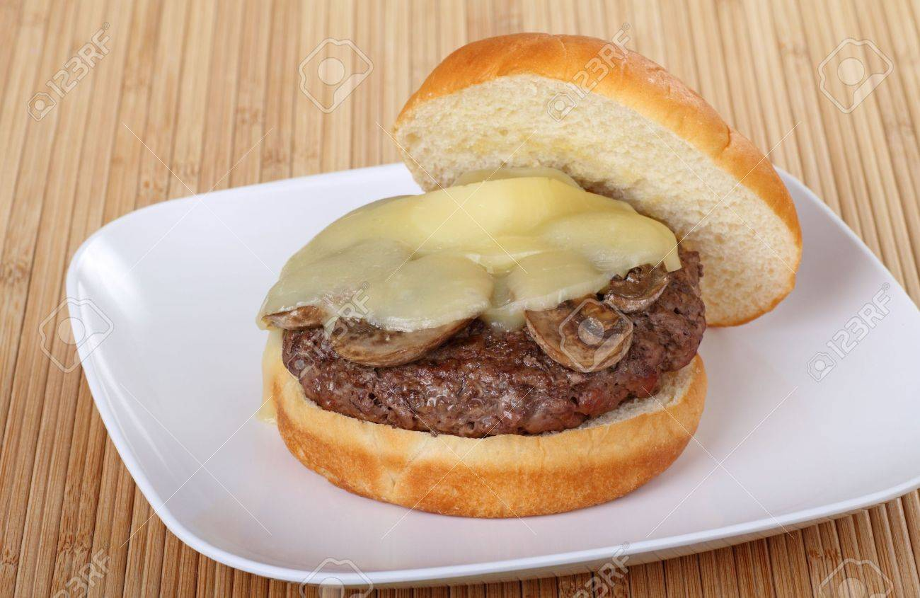 Mushroom burger with melted cheese on a plate Stock Photo - 7897544