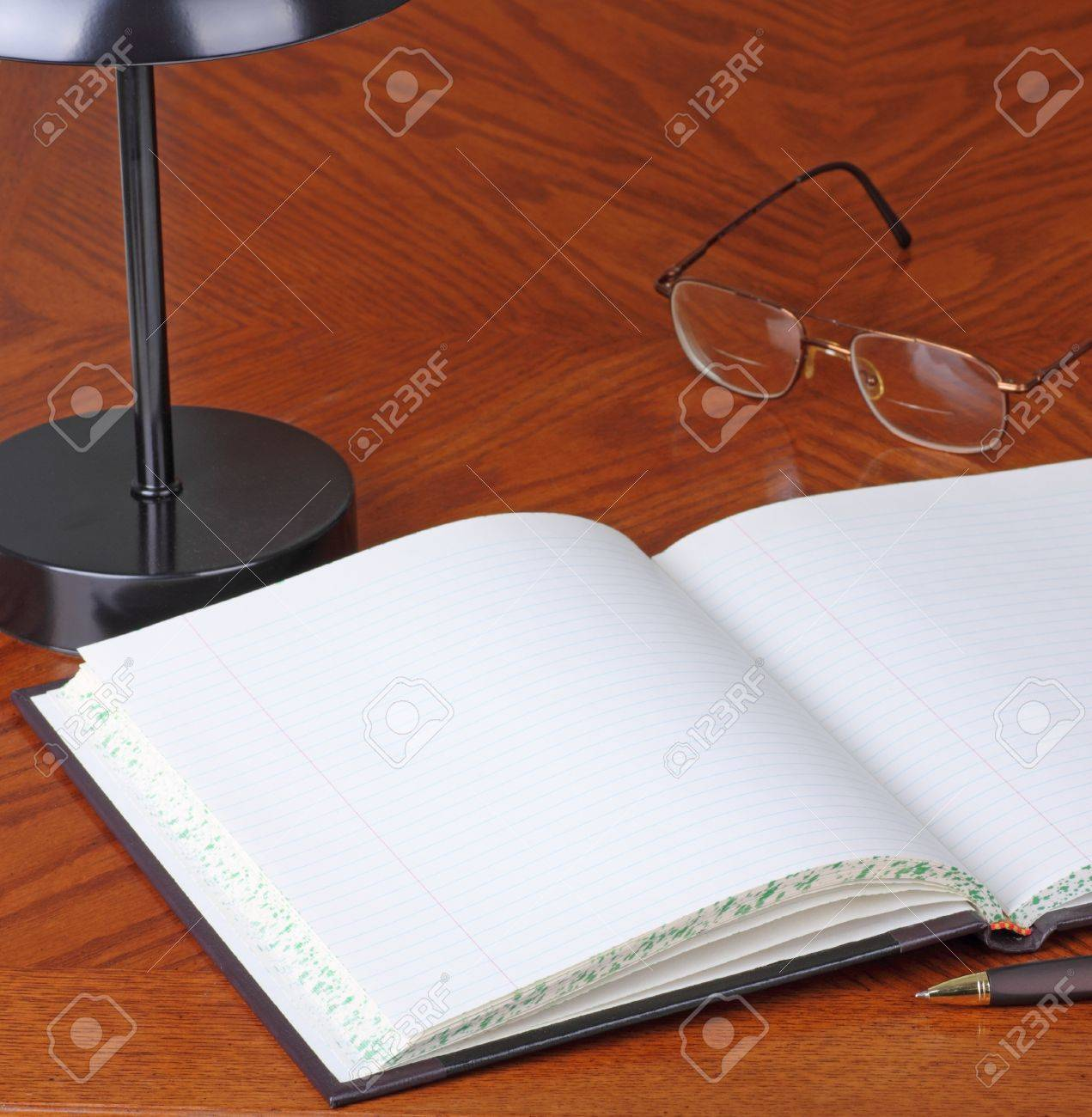 blank open logbook on a desk with pen stock photo picture and