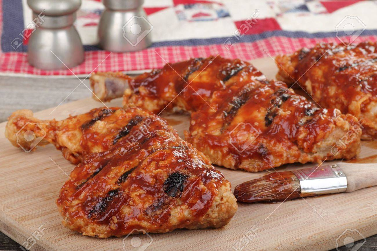 Bbq Chicken Quarters On A Cutting Board Stock Photo Picture And