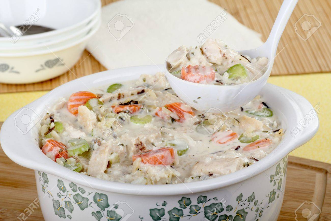 Laddle serving chicken and rice soup with vegetables Stock Photo - 16000130