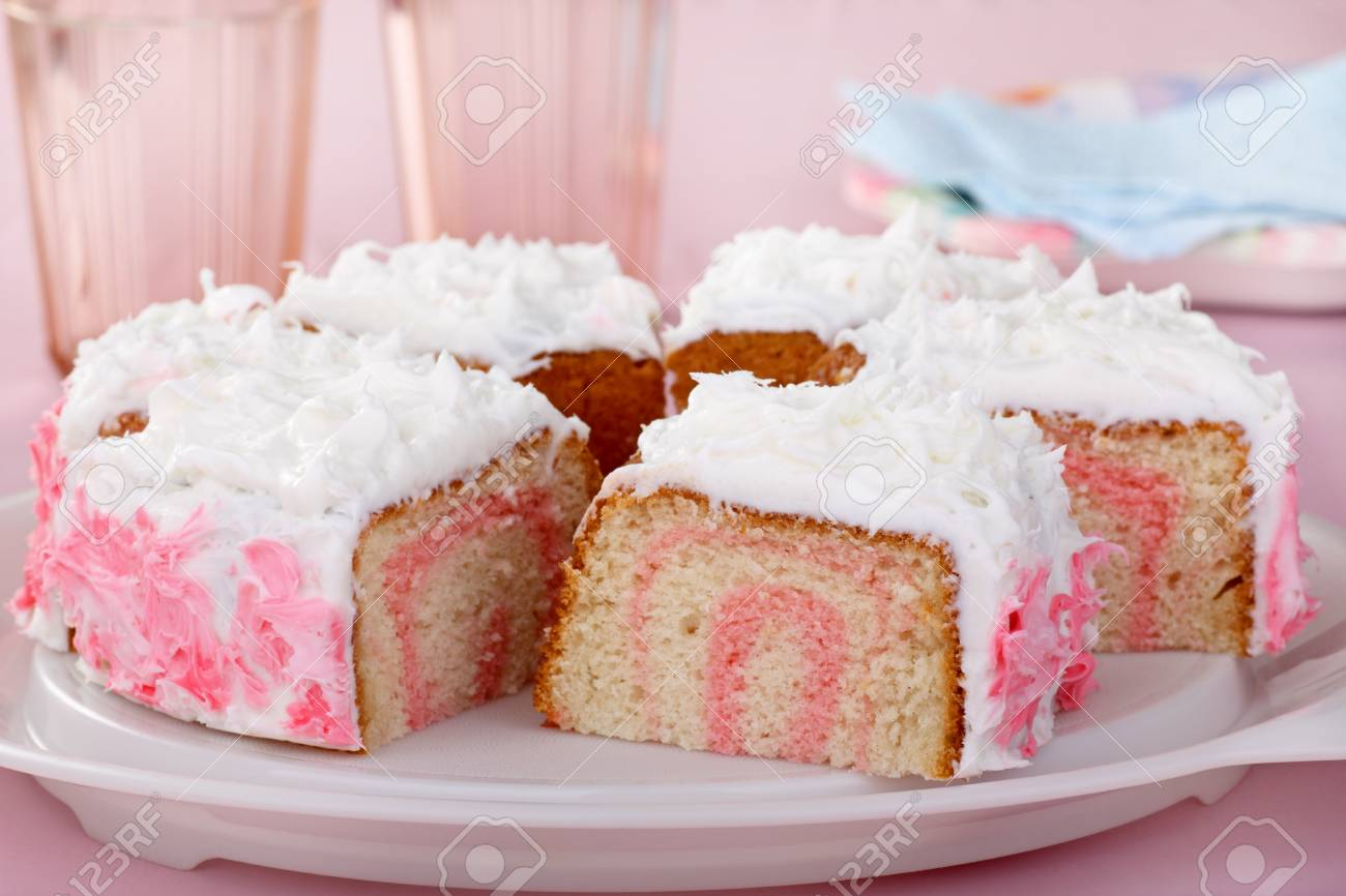 Sliced cake with white and pink frosting Stock Photo - 16783067