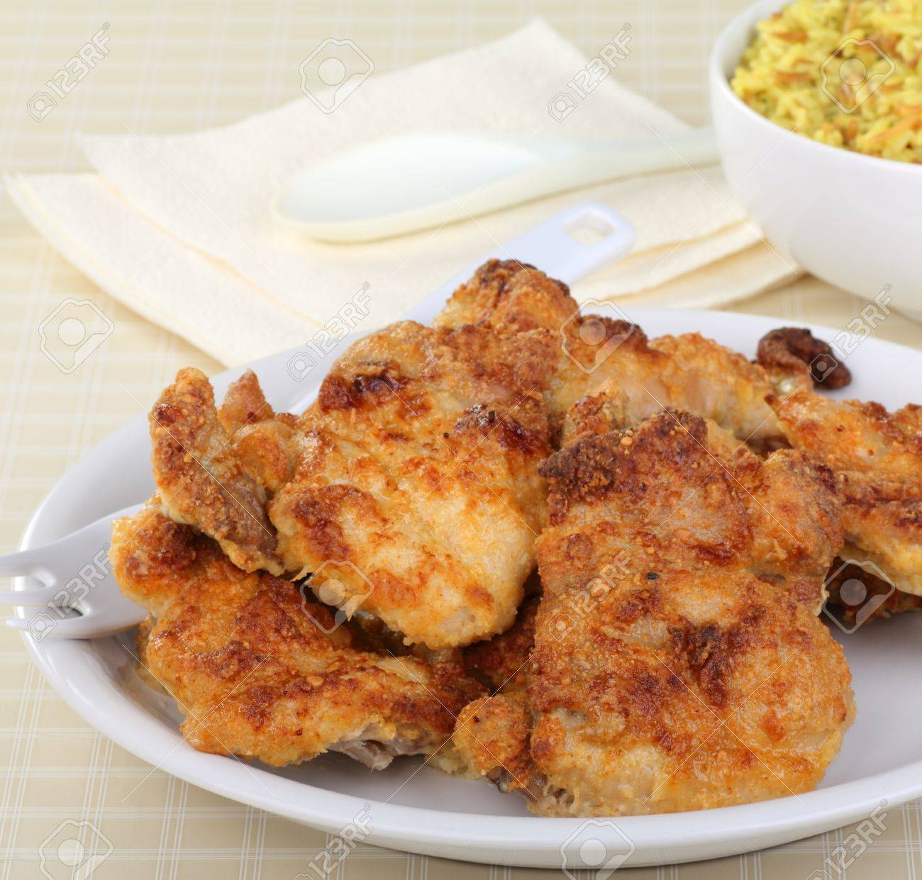 Baked breaded chicken thighs on a serving plate Stock Photo - 17038207