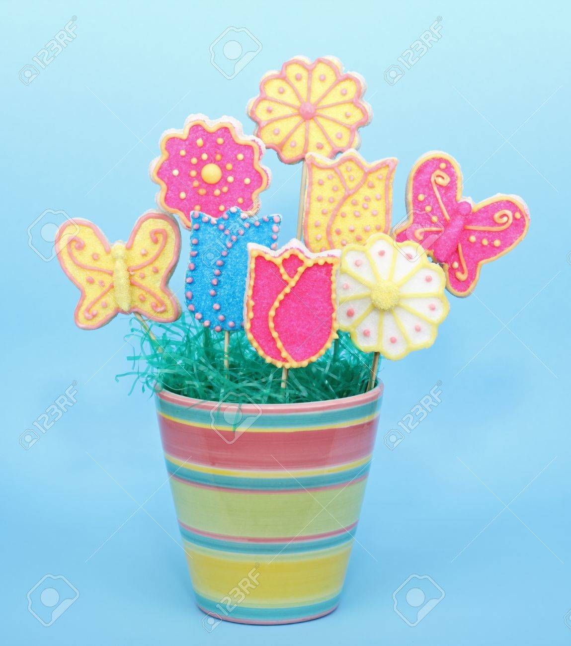 239 & Sugar cookies in a flower pot on a blue background