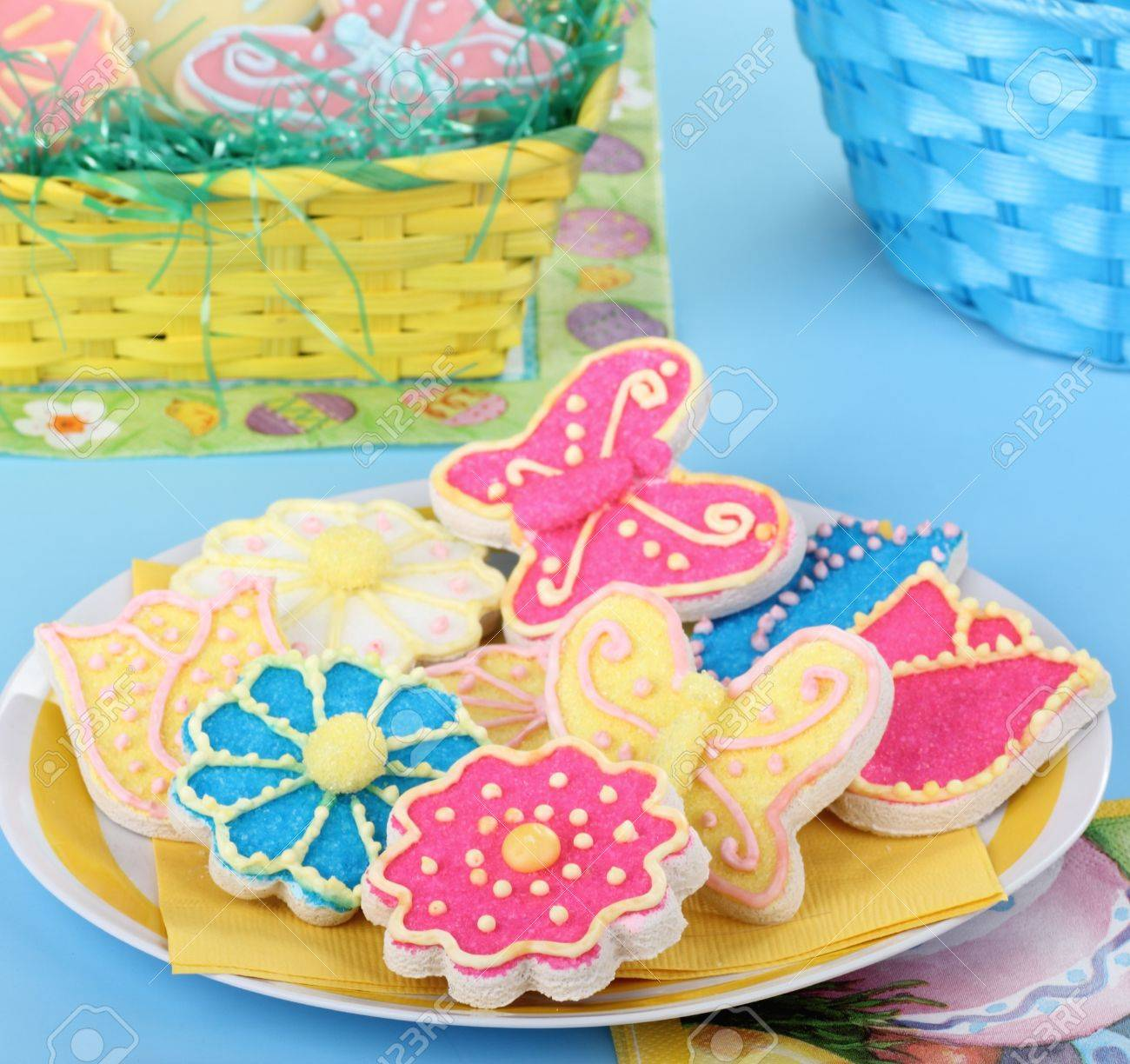 Flower and butterfly cookies with easter baskets in background Stock Photo - 17596845