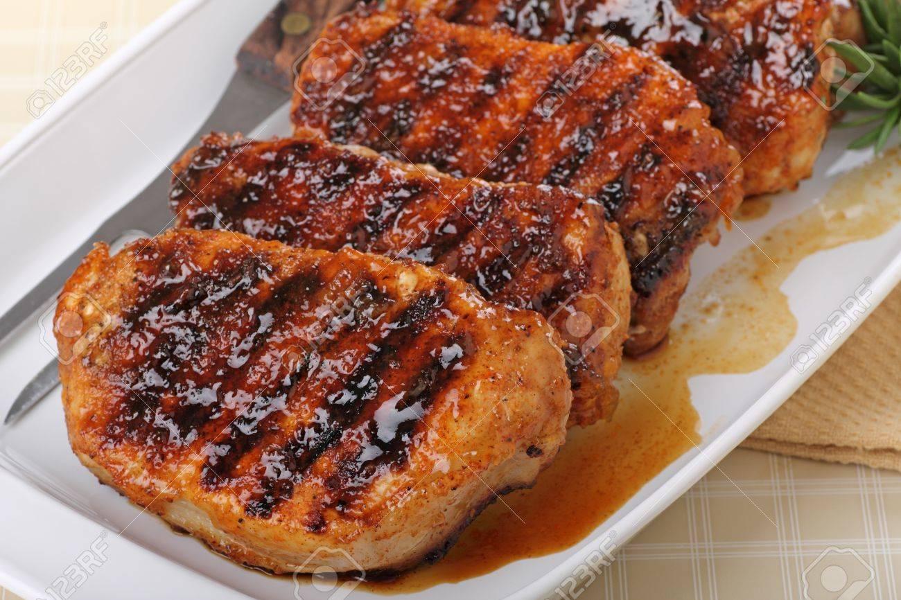 Grilled pork tenderloins on a serving platter Stock Photo - 18630114