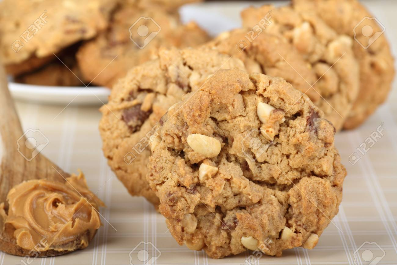 Closeup of peanut butter cookies with spoon of peanut butter alongside Stock Photo - 18755778