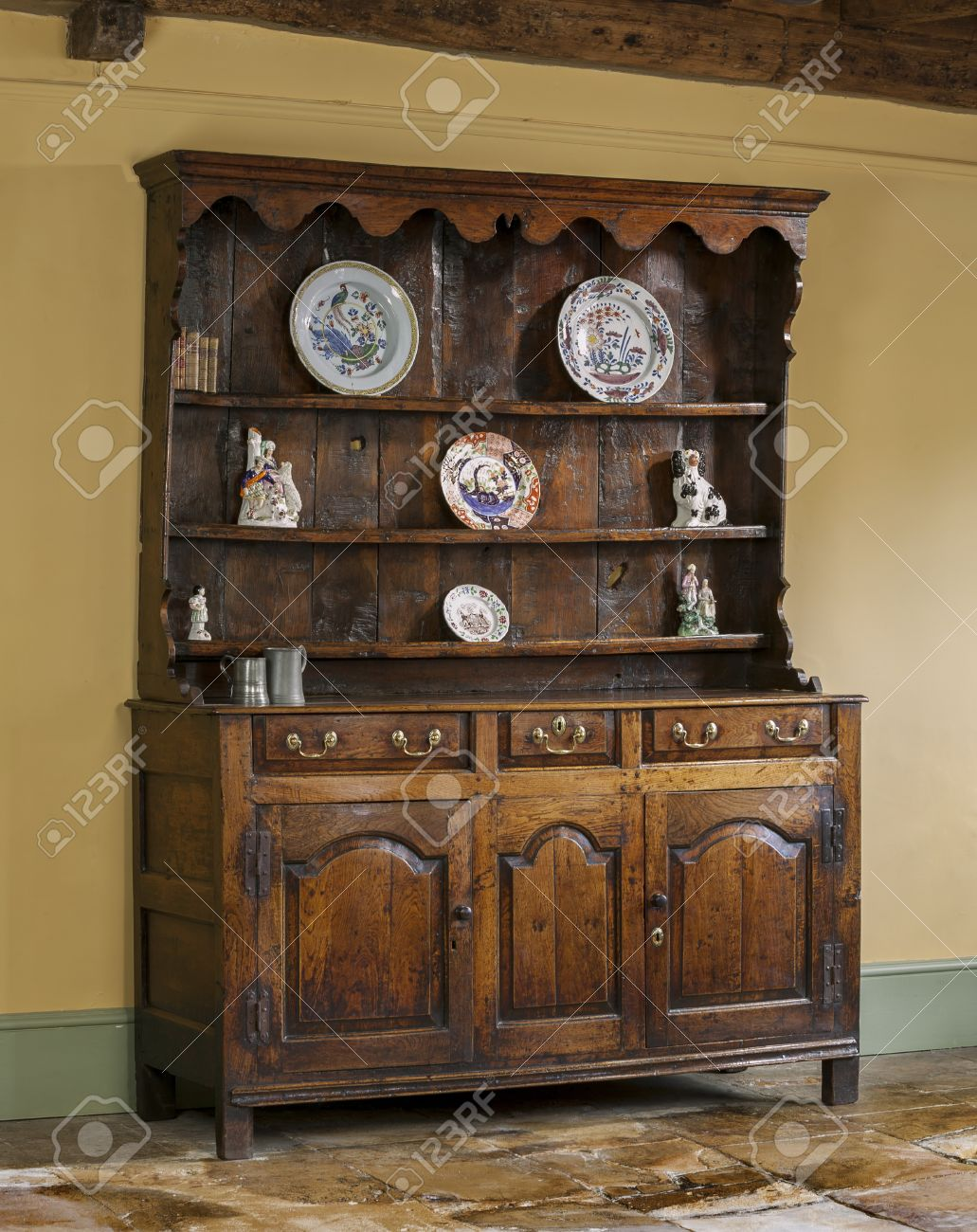 old antique hand made and oak carved English wooden kitchen dresser Stock  Photo - Antique Furniture Stock Photos. Royalty Free Business Images