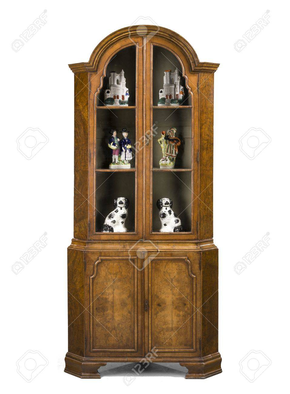 old antique corner cupboard in walnut and in the style of Queen Anne  English isolated on - Old Antique Corner Cupboard In Walnut And In The Style Of Queen