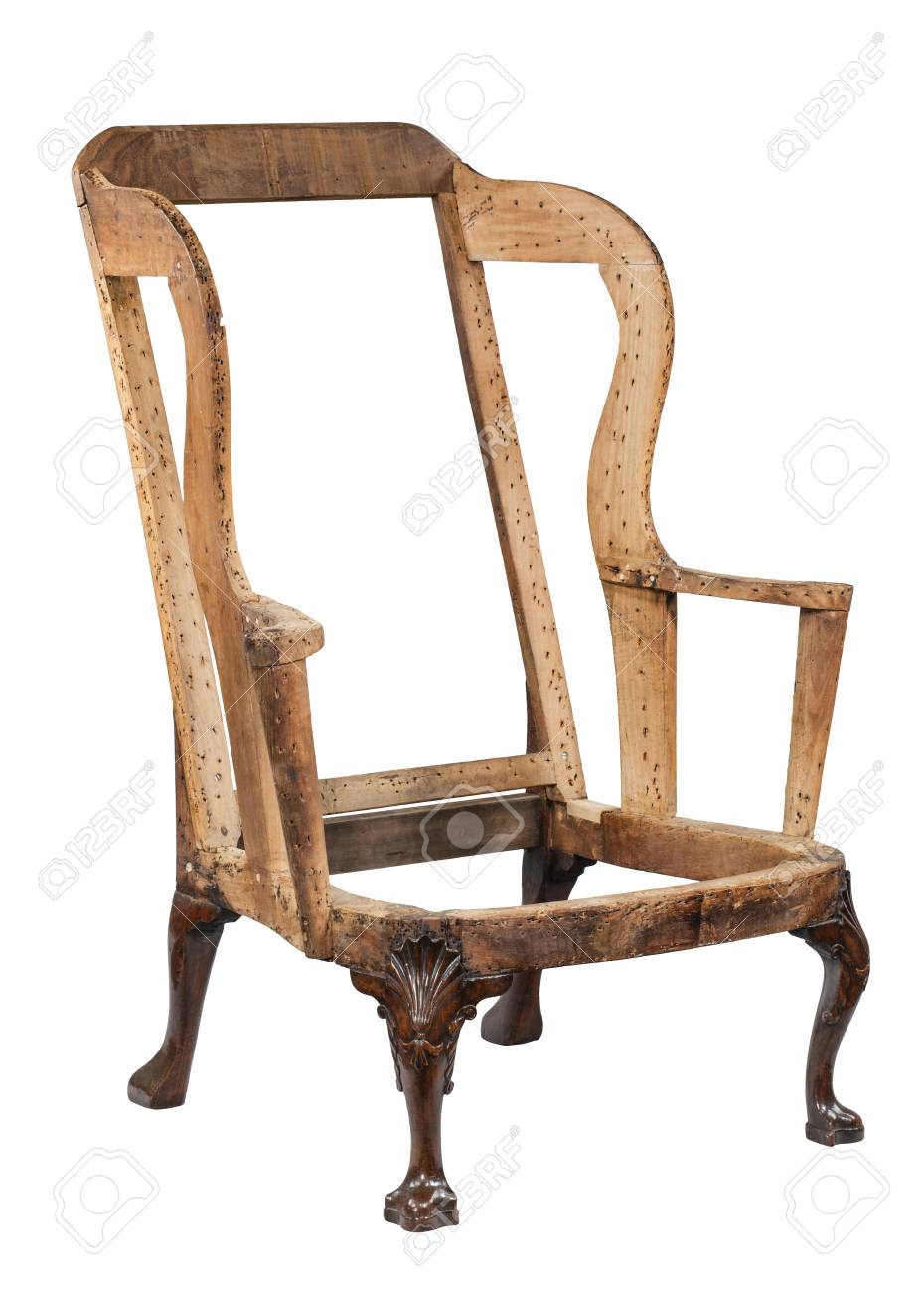 original stripped down before restoration old antique arm chair isolated  with clipping path Stock Photo - - Original Stripped Down Before Restoration Old Antique Arm Chair