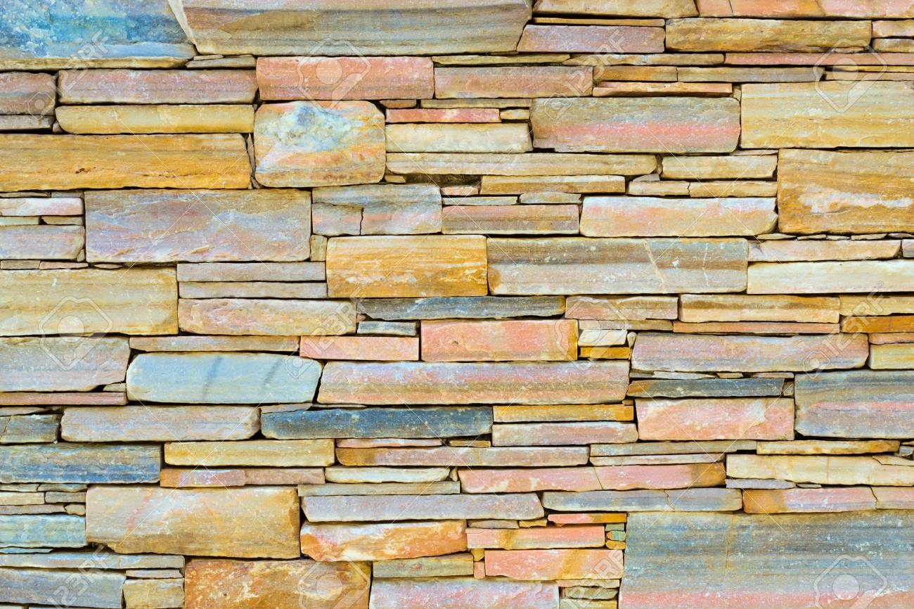 prodigious Decorative Stone Wall Part - 15: Decorative stone wall, pieces of rock bonded with cement. Cobble texture  with cracks.