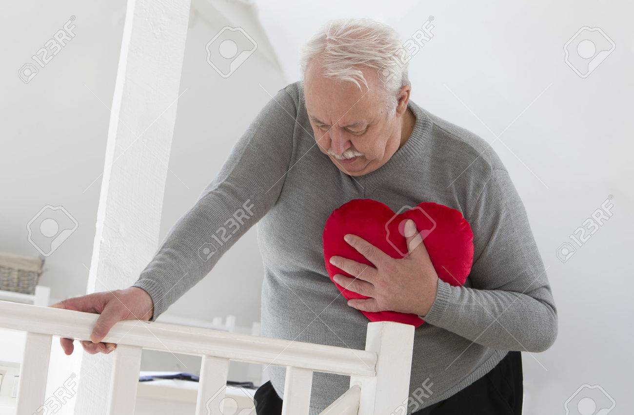 Angina images stock pictures royalty free angina photos and senior man holding an heart symbol of heart attack biocorpaavc