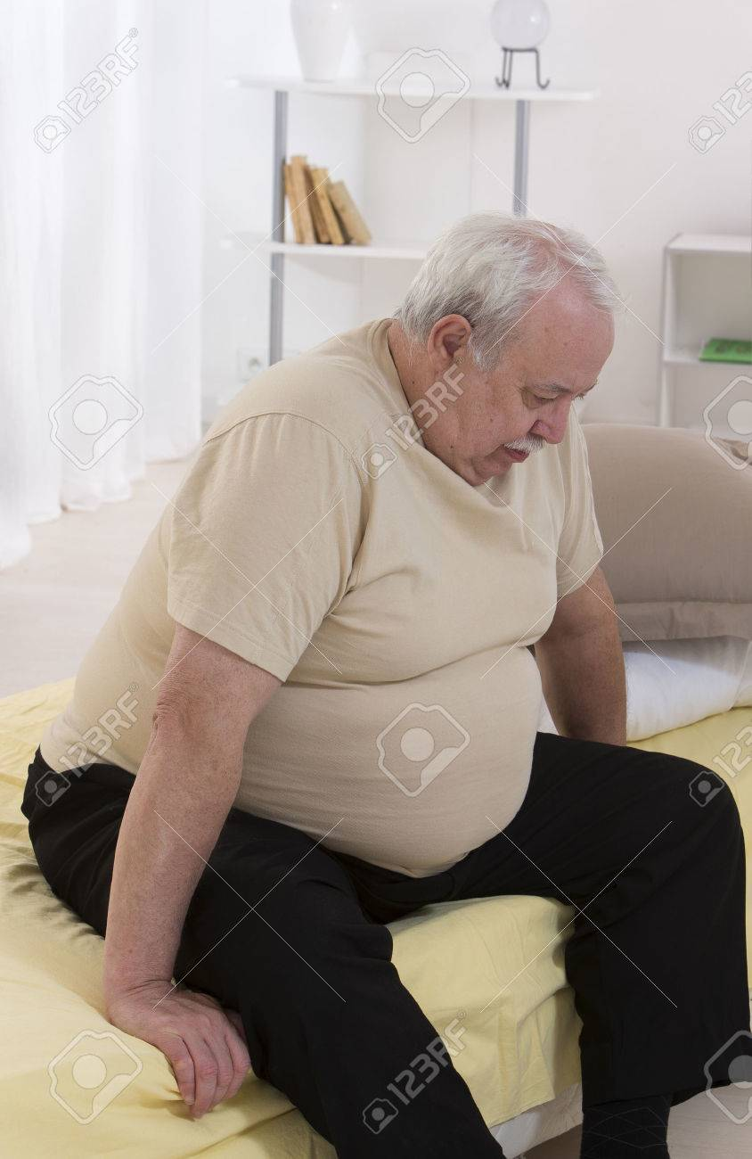 Overweight senior man Concerned With His health - 34785491