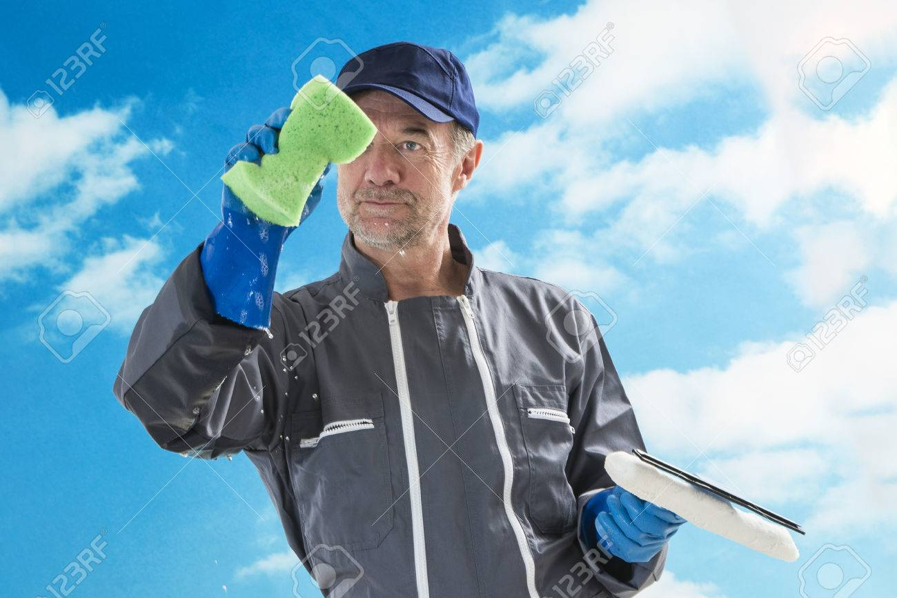 a professional window cleaner sponge and squeegies a window clean