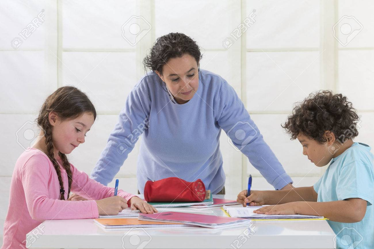 Mother Helping Children With Homework In living room - 48278291