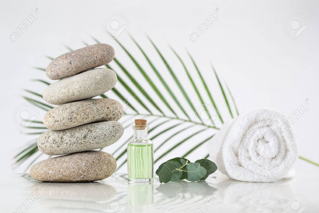 spa accessories with stones on white background - 50092822