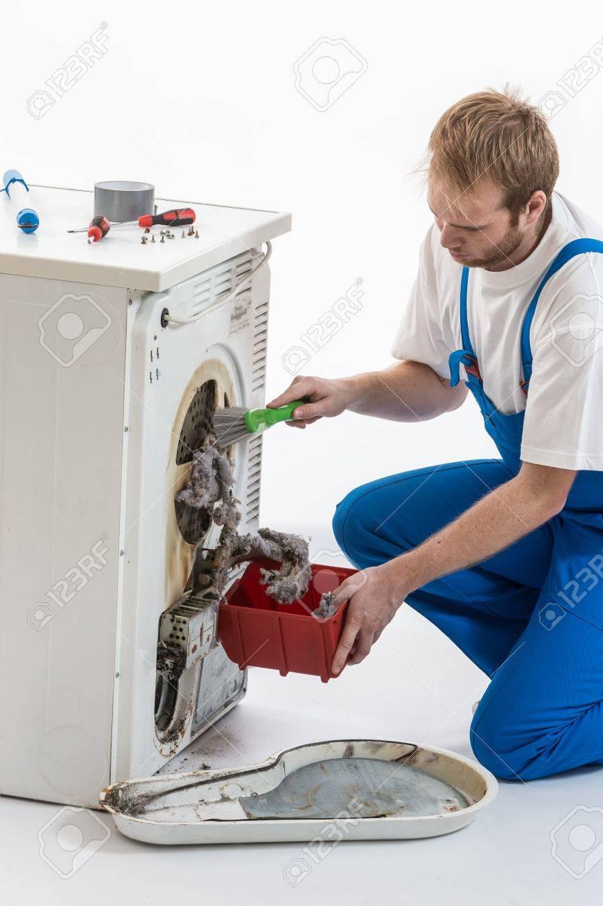 Male Technician repairing Washing Machine and Dryer - 50347546