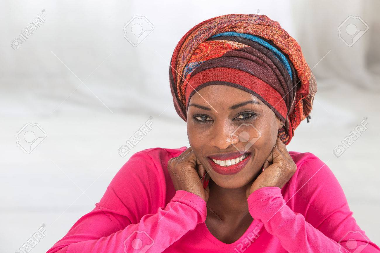 Beautiful African woman wearing a headscarf - 52795214