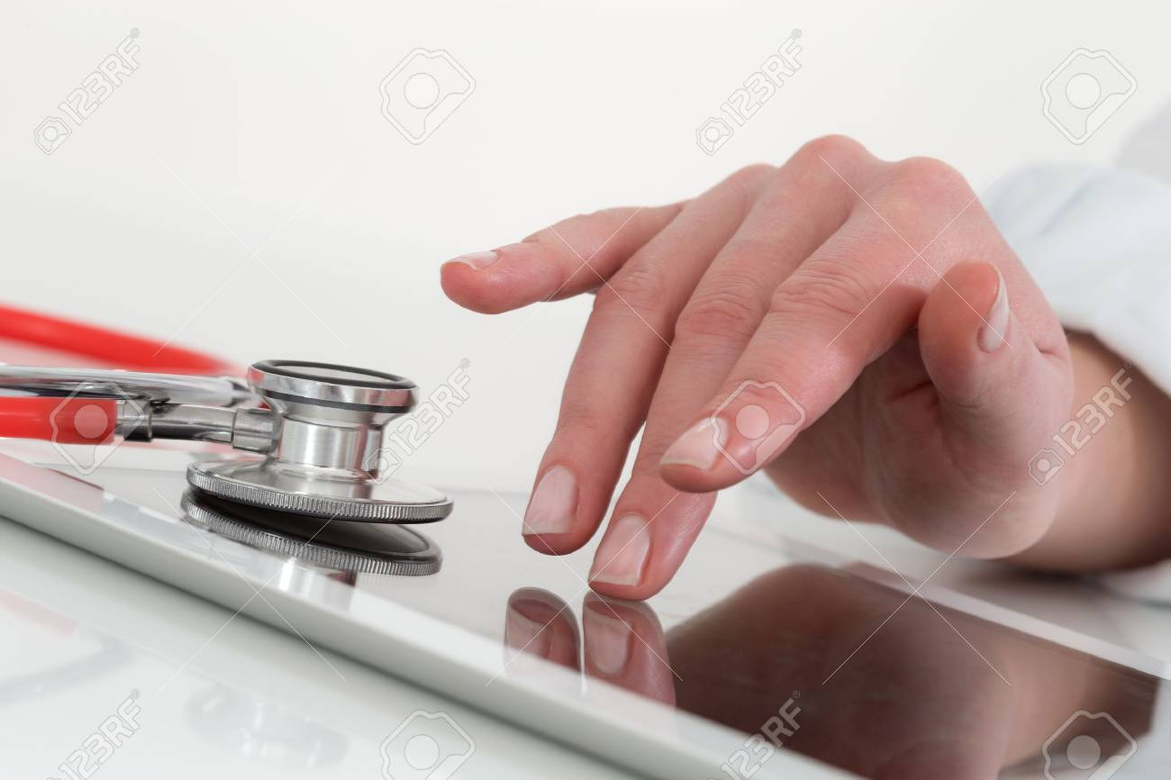 Doctor working with digital tablet in medical workspace office - 53992729