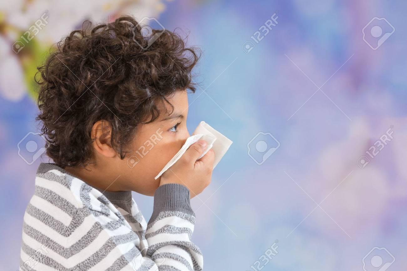 Kid blowing his nose Seasonal virus - 54118616