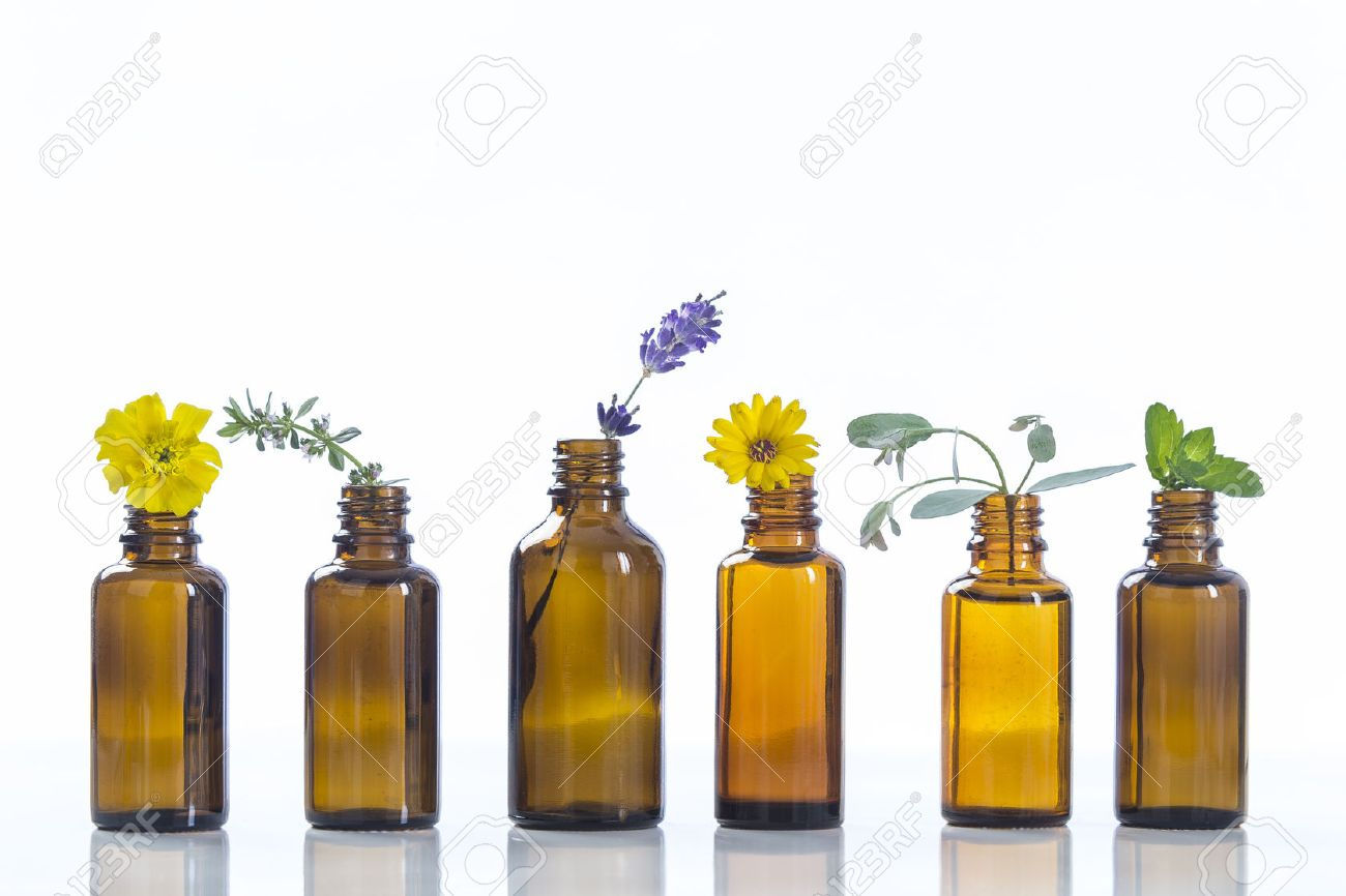 essential oils and medical flowers herbs on white - 62013001