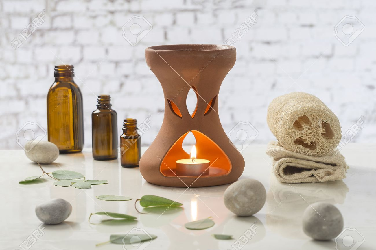 Aromatherapy candles burning and bath towels for a relaxation - 63618354