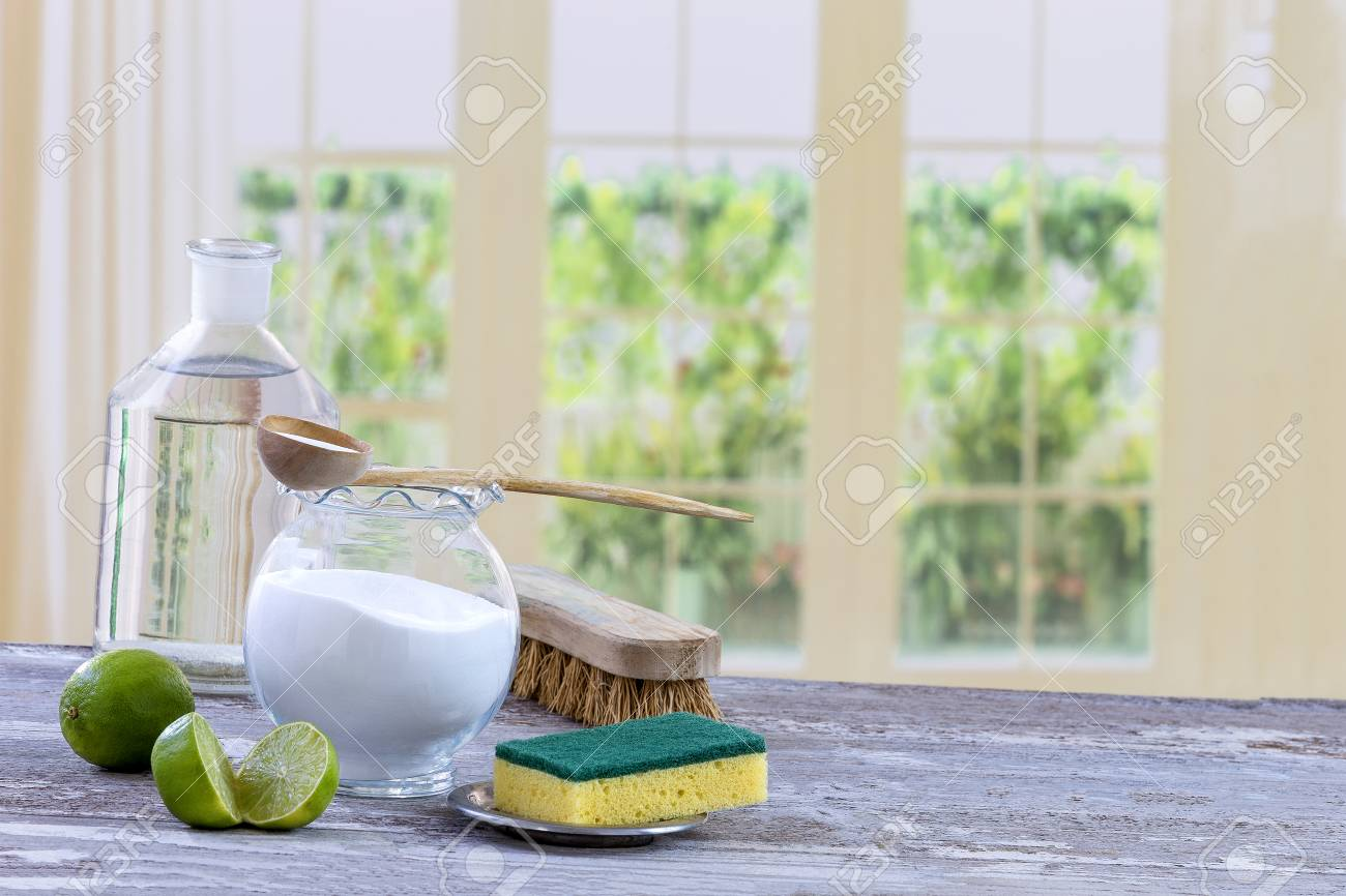 Eco-friendly natural cleaners baking soda, lemon and cloth on wooden table kitchen background, - 90410682