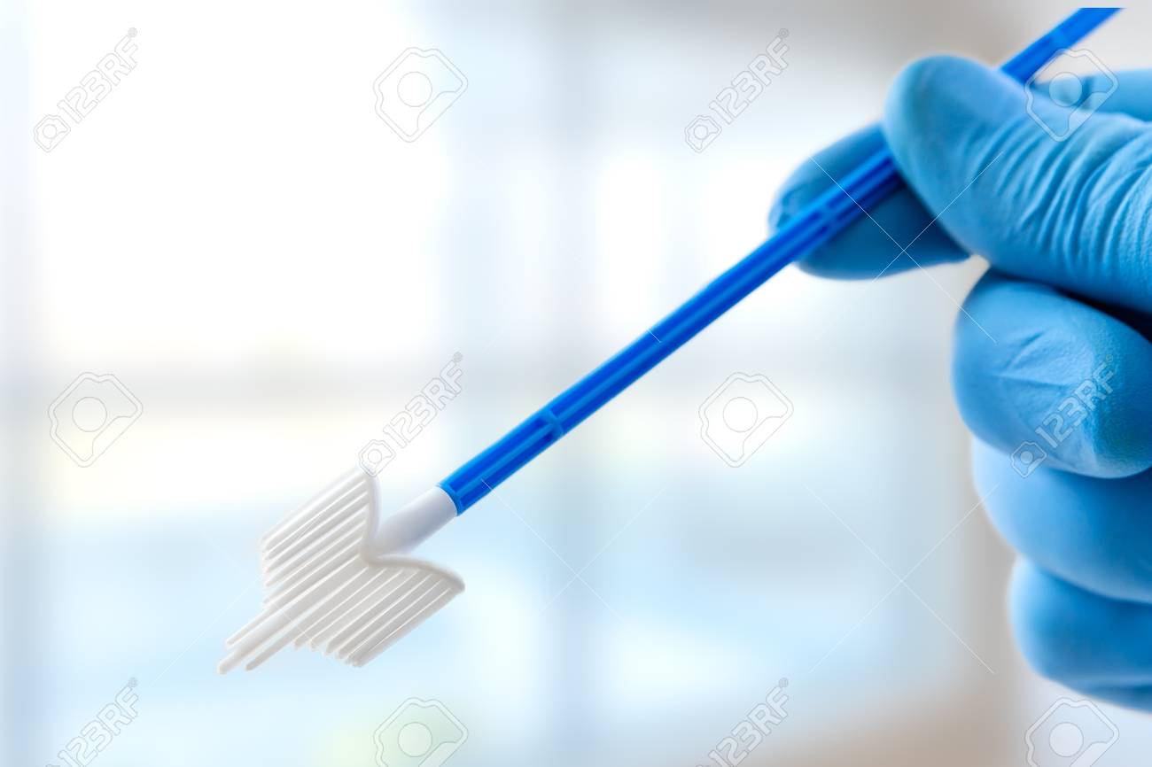 gloved hands holding vaginal smear, medical tools for medical investigation. Feminine woman health diagnosis - 121654589