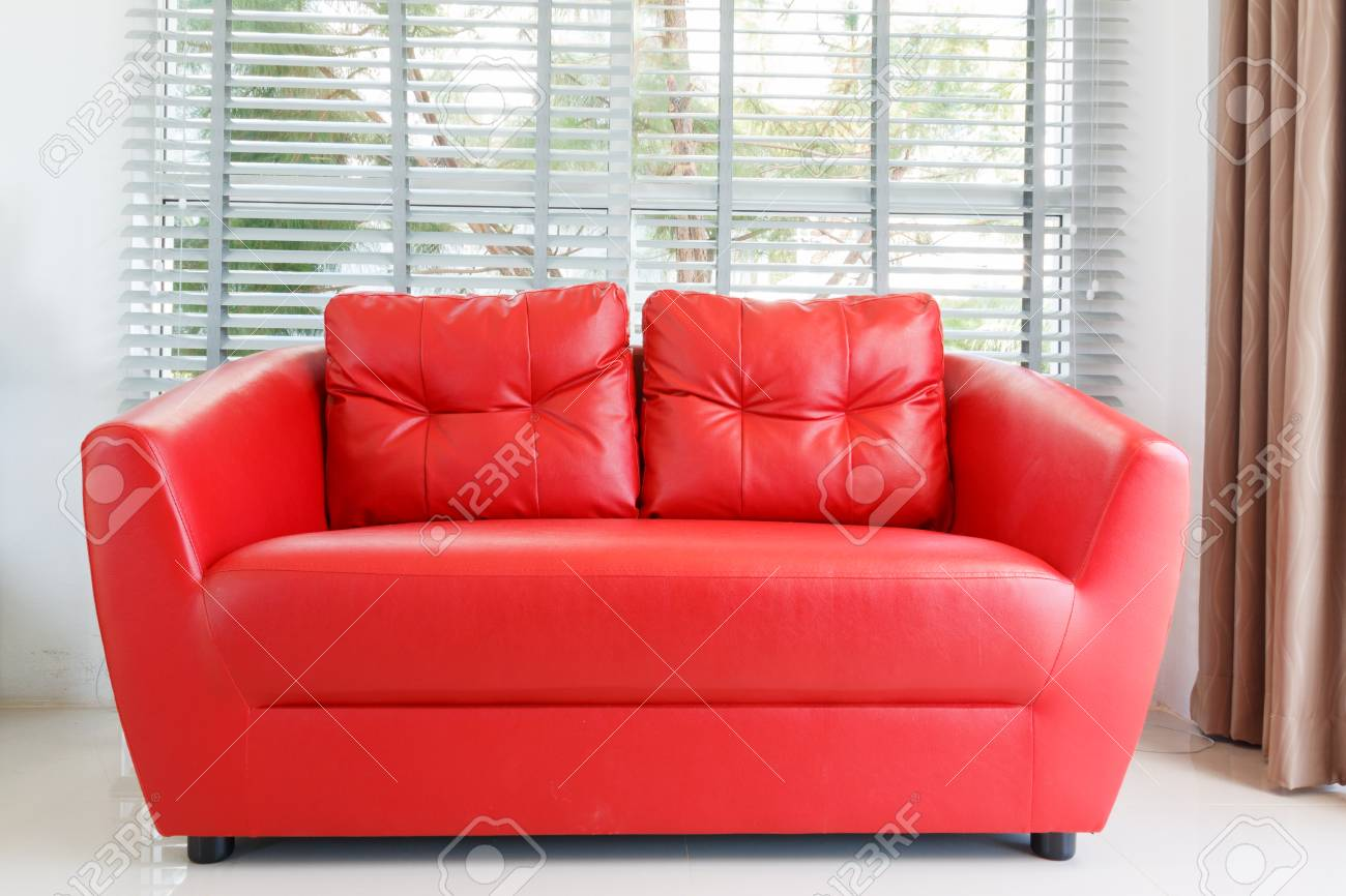 Modern home with living room and red sofa