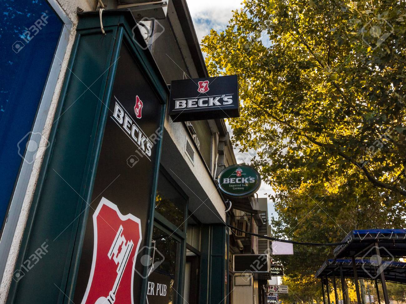 BELGRADE, SERBIA - SEPTEMBER 27, 2018: Logo of Beck's beer on a bar sign with its distinctive visual. Becks is a German light pilsner beer belonging to Interbrew groupPicture of a sign showing the logo of Beck's Beer, on a Serbian bar. Beck's is a light - 111379795