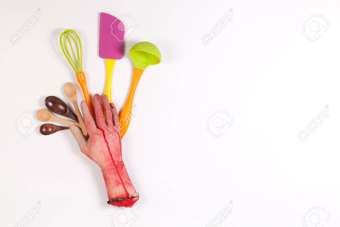 Zombie Hand with Colorful kitchen utensils on white background
