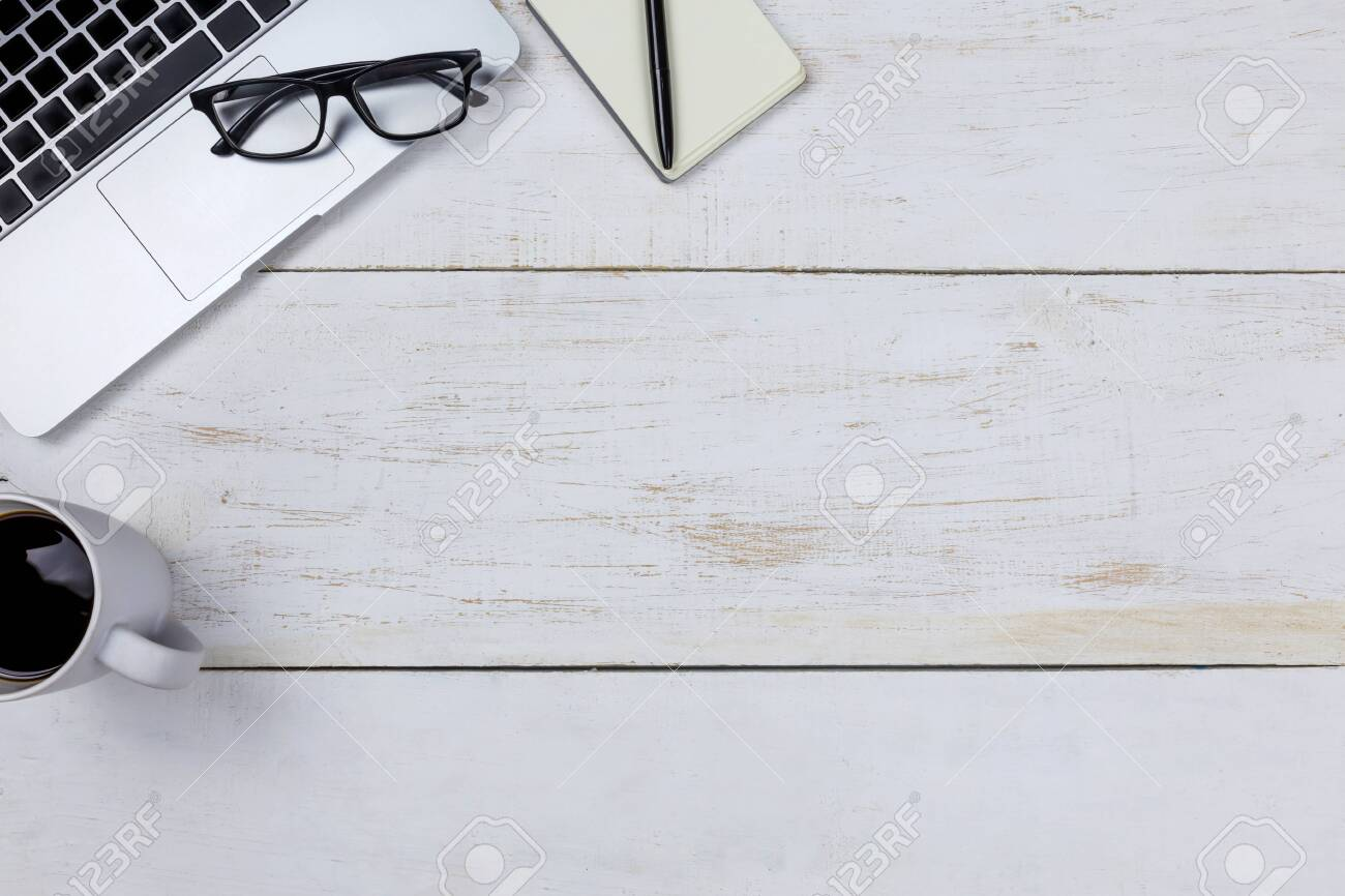 flat lay Office desk table of modern workplace with laptop on white wooden table, top view laptop background and copy space on white background, White desk office with laptop, smartphone and other work supplies with cup of coffee. - 123400937